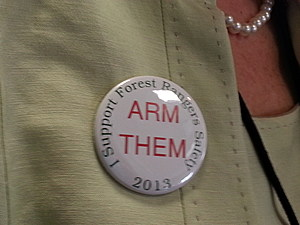 Proponents of an effort to equip and train Maine's Forest Rangers with sidearms display their message at public hearings in Augusta earlier this year. Photo -Susan Patten/ Townsquare Media